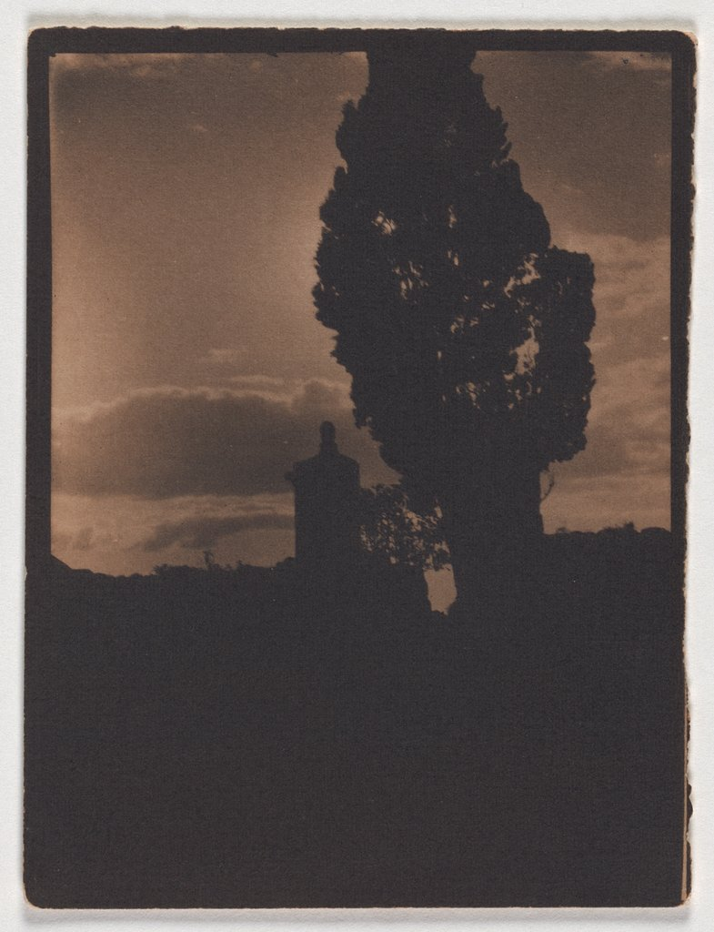 Silhouette of tree and tower in the evening sky, Adolphe de Meyer