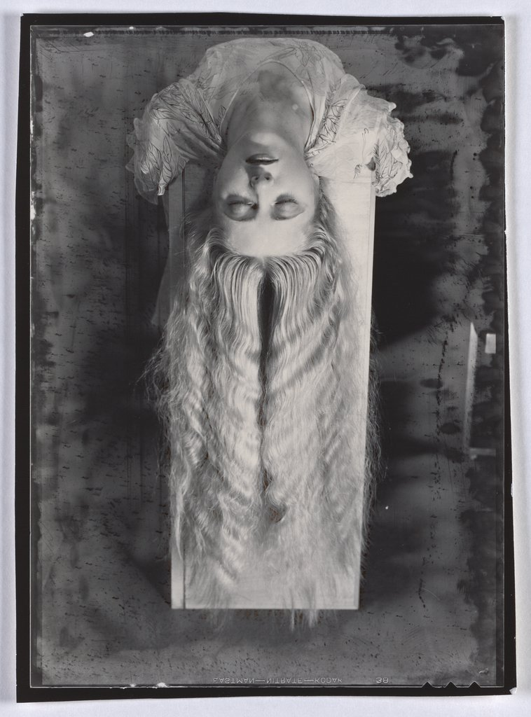 Long-haired woman, Man Ray